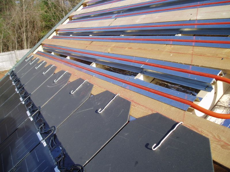 Dawn solar pv thermal with pv tiles during install